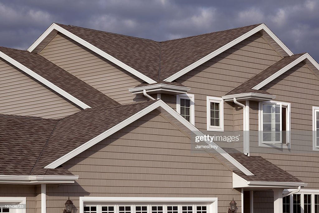 home exterior with architectural asphalt shingle gabled