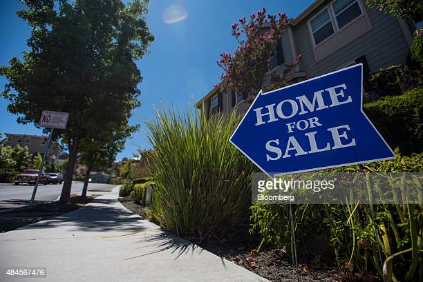 A 'Home For Sale' sign is displayed outside a house in Martinez California US on Tuesday Aug 11 2015 The National Association of Realtors is...
