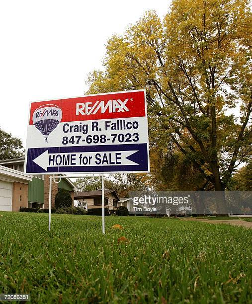 A 'Home for Sale' sign points to an existing singlefamily residence for sale October 4 2006 in Park Ridge Illinois The slowing of home sales is...