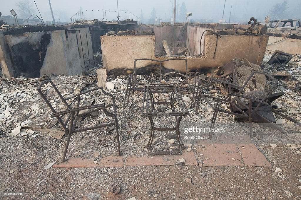 Home foundations and remains of possessions are nearly all that remain in a residential neighborhood destroyed by a wildfire on May 6, 2016 in Fort McMurray, Alberta, Canada. Wildfires, which are still burning out of control, have forced the evacuation of more than 80,000 residents from the town.