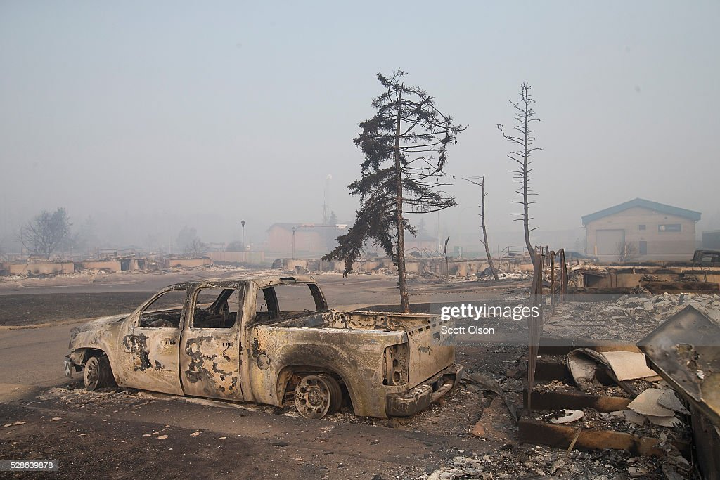 Home foundations and shells of vehicles are nearly all that remain in a residential neighborhood destroyed by a wildfire on May 6, 2016 in Fort McMurray, Alberta, Canada Wildfires, which are still burning out of control, have forced the evacuation of more than 80,000 residents from the town.