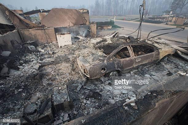 Home foundations and shells of vehicles are nearly all that remain in a residential neighborhood destroyed by a wildfire on May 6 2016 in Fort...