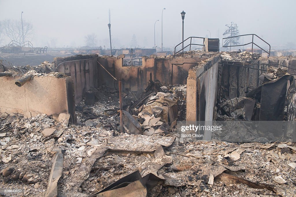 Home foundations are all that remain in a residential neighborhood destroyed by a wildfire on May 6, 2016 in Fort McMurray, Alberta, Canada Wildfires, which are still burning out of control, have forced the evacuation of more than 80,000 residents from the town.