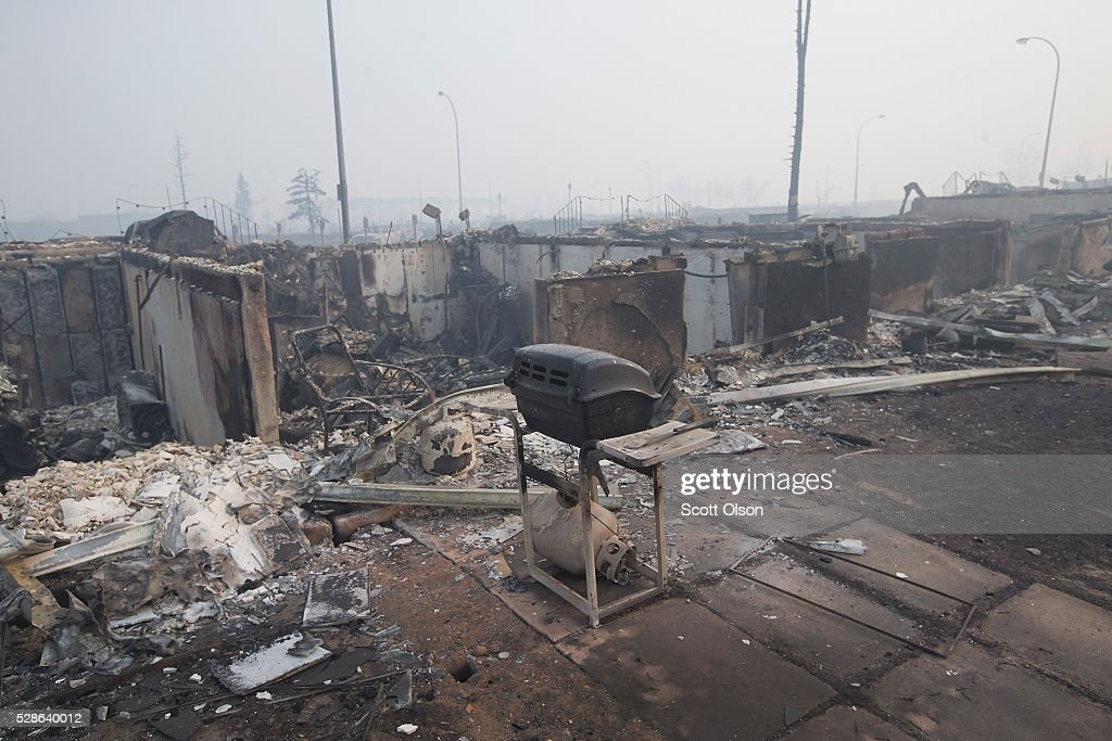 Home foundations are nearly all that remain in a residential neighborhood destroyed by a wildfire on May 6, 2016 in Fort McMurray, Alberta, Canada Wildfires, which are still burning out of control, have forced the evacuation of more than 80,000 residents from the town.