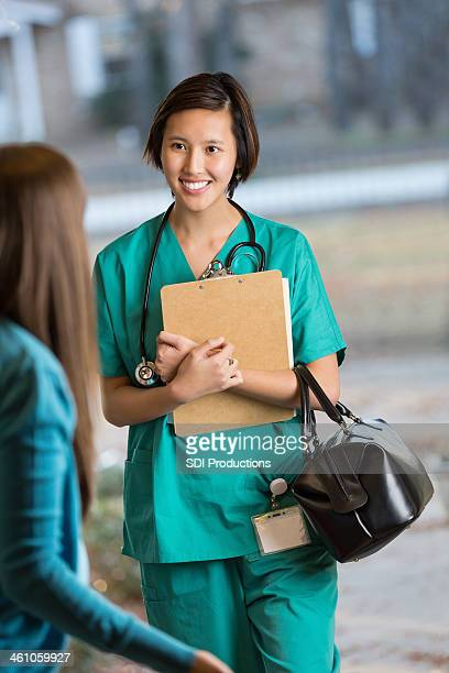 Home healthcare doctor or nurse entering house of patient