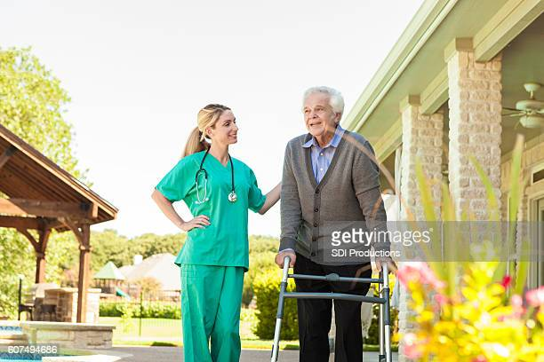 Home healthcare nurse encourages patient during exercise