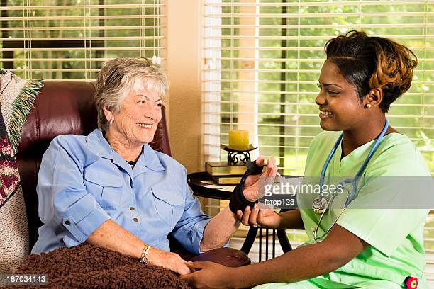 Home healthcare nurse visiting injured patient