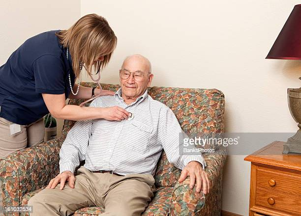 Home Healthcare Worker Checking Heart of Senior Patient
