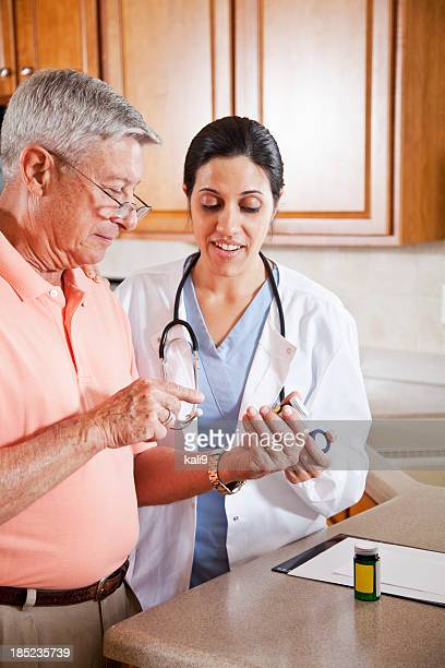 Home healthcare worker with prescriptions for senior man