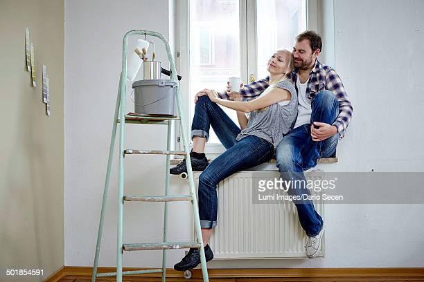Home improvement, happy couple taking a break, Munich, Bavaria, Germany