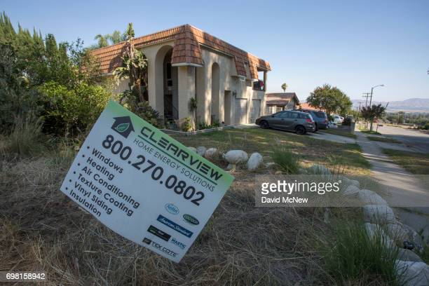 A home improvement project sign is seen on a home a few houses away from the San Andreas Fault on June 18 2017 in Highland California An earthquake...