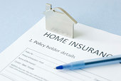 home insurance document on blue background