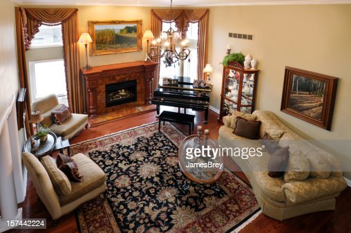 Home interior formal living room piano persian rug fire place stock photo getty images - Deluxe persian living room designs with artistic rug collection ...