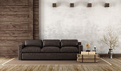 Home interior in rustic style with leather couch and old wooden paneling - 3d Rendering