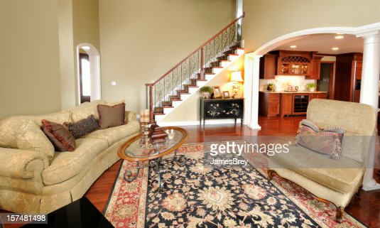 Home interior living room persian rug pillars staircase spacious open stock photo getty images - Deluxe persian living room designs with artistic rug collection ...
