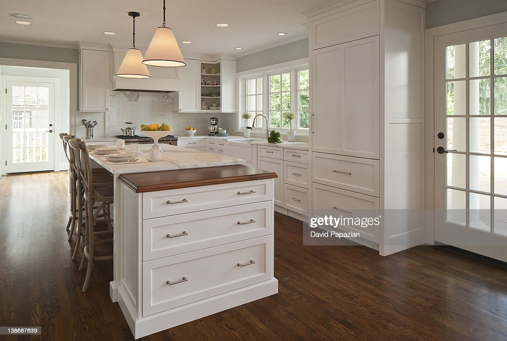 Home interior space of kitchen with lights on. : Stock Photo