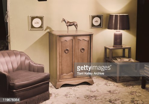 Home Interior With Horse Sculpture On Cupboard Stock Photo