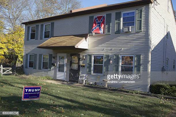 A home is decorated with a Donald Trump sign and a confederate flag in rural Schuylkill County in Pennsylvania an economically depressed region...