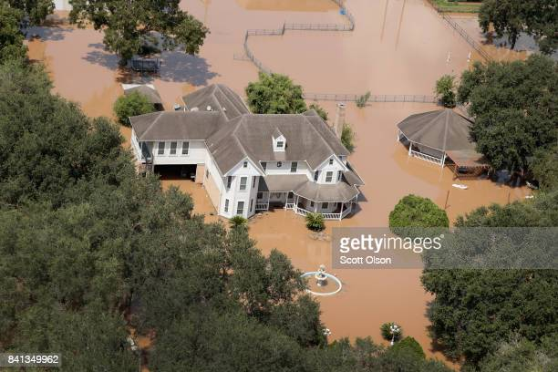 A home is surrounded by floodwater after torrential rains pounded Southeast Texas following Hurricane and Tropical Storm Harvey on August 31 2017...