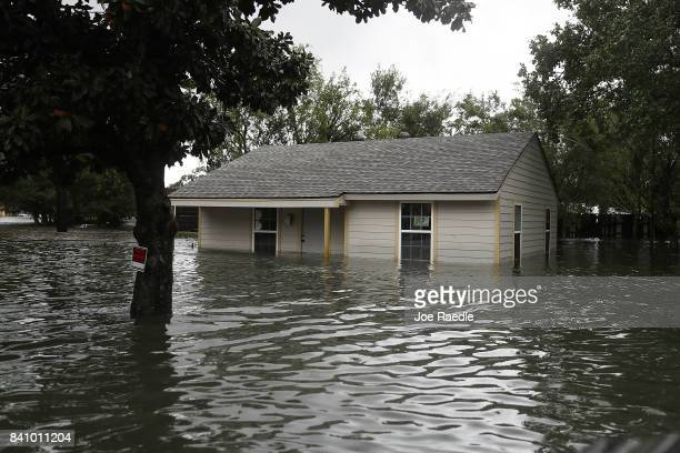 A home is surrounded by water after the flooding of Hurricane Harvey inundated the area on August 30 2017 in Port Arthur Texas Harvey which made...
