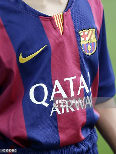home kit shirt of FC Barcelona 20142015 nike logo qatar airways logo during the friendly match between Napoli and FC Barcelona at Stade de Geneve on...