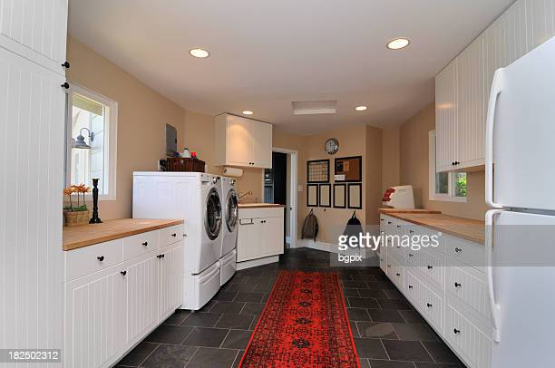 A home laundry room with red carpet