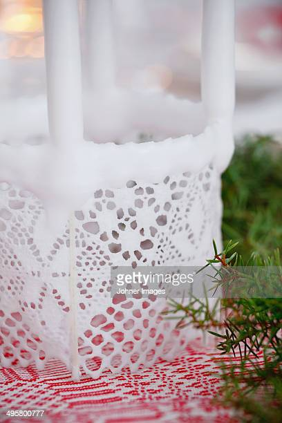 Home made candle with lace decorations