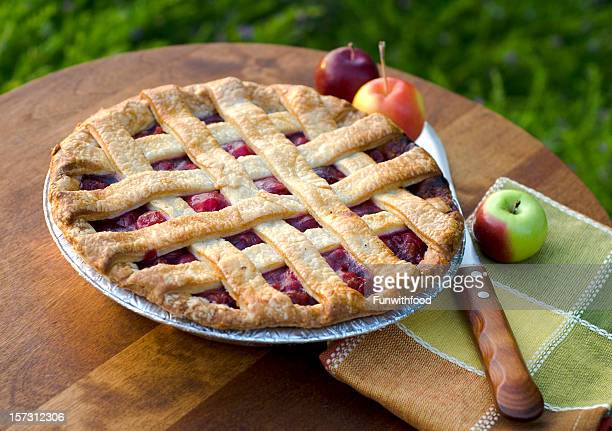 A home made cherry pie on a wooden table