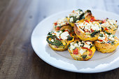 Home made chicken and egg muffins, with spinach, capsicum and feta cheese