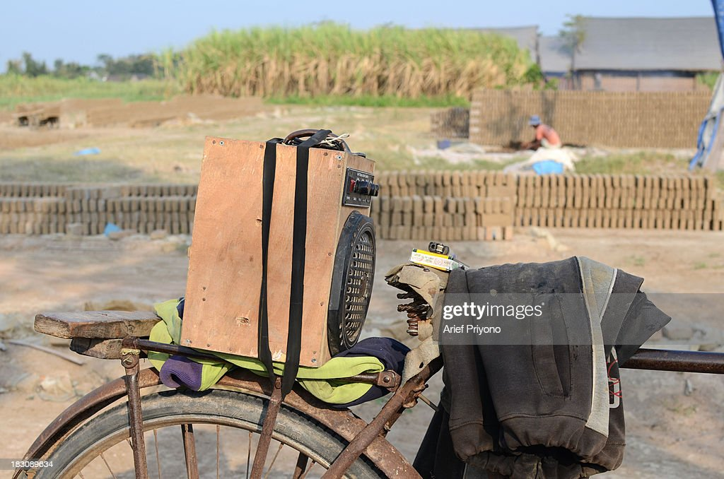 A home made music player strapped to the back of a bicycle provides entertainment for workers in a brickyard in a sugarcane field in Silir village. Many farmers in Indonesia have had to convert agricultural land because it is no longer profitable. Consequently Indonesian agricultural production has declined. Although Indonesia is an agricultural country, it still has to rely heavily on imported food staples such as rice, sugar, soybeans and corn. The Central Statistics Agency (BPS) announced that the number of farming households in Indonesia has decreased by 5.04 million families in the past 10 years. The 2003 Census of Agriculture claimed 31.17 million farm households. But in 2013 the number had fallen to 26.13 million. Indonesia has been listed as the world's largest sugar exporter. In 1930, when Indonesia was still called the Dutch East Indies, some 179 sugar factories produced over 3 million tons of sugar each year. Currently there are only 62 sugar factory in Indonesia..