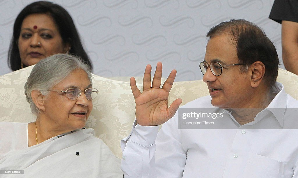 Home Minister P. Chidambaram (R) and Chief Minister <a gi-track='captionPersonalityLinkClicked' href=/galleries/search?phrase=Sheila+Dikshit&family=editorial&specificpeople=728110 ng-click='$event.stopPropagation()'>Sheila Dikshit</a> (L) inaugurate the Automated Multi Level Car Parking 'Capitol Point' at Baba Kharak Singh Marg on June 12, 2012 in New Delhi India. The 10 floor automated multi-level car parking has a capacity of 1,408 vehicles.