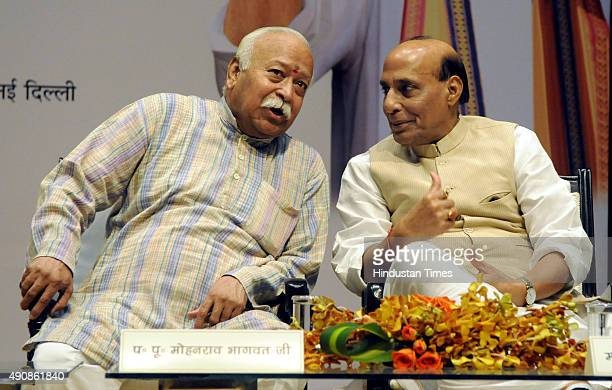 Home Minister Rajnath Singh and RSS Chief Mohan Rao Bhagwat at the 90th birth celebration of VHP Chief Ashok Singhal on October 1 2015 in New Delhi...