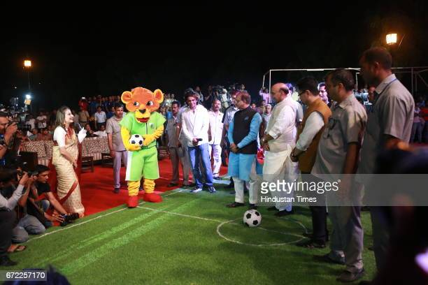 Home Minister Rajnath Singh and Sports Minister Vijay Goel look at Mascot Gabru during the launch of Oorja by CAFP U19 Football Talent Tournament at...