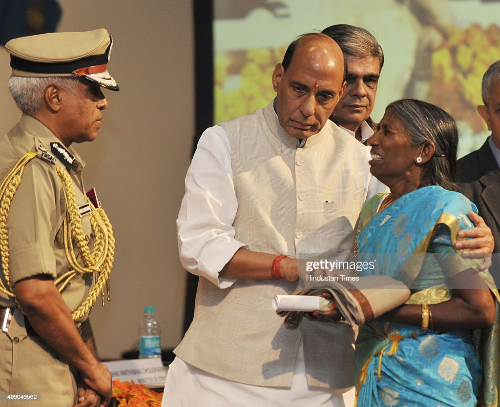 Home Minister <a gi-track='captionPersonalityLinkClicked' href=/galleries/search?phrase=Rajnath+Singh&family=editorial&specificpeople=582959 ng-click='$event.stopPropagation()'>Rajnath Singh</a> consoles the weeping mother of martyr CRPF jawan CT S Prabhu as he presents a medal at the CRPF Valour Day ceremony on April 9, 2015 in New Delhi, India.