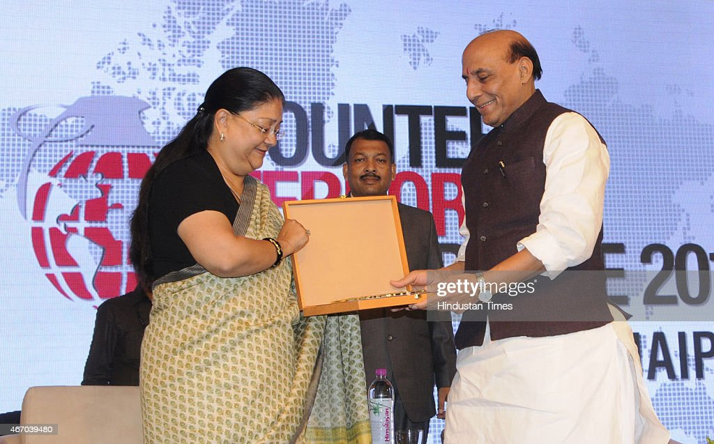 Home Minister Rajnath Singh receives a memento from Rajasthan Chief Minister Vasundhara Raje at the inaugural session of Counter Terrorism Conference...