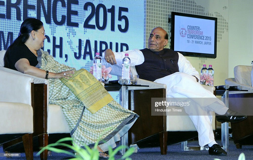 Home Minister Rajnath Singh talks with Rajasthan Chief Minister Vasundhara Raje at the inaugural session of Counter Terrorism Conference 2015 at...