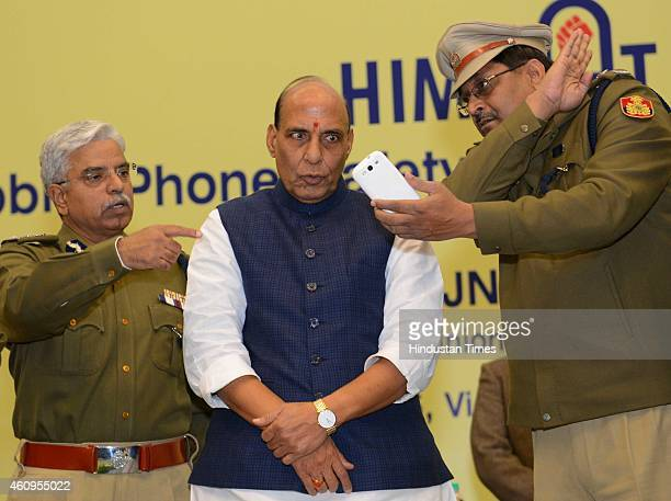 Home minister Rajnath Singh with Delhi Police Commissioner BS Bassi during the launch of mobile phone based application Himmat for the safety of...