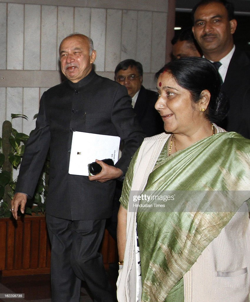Home Minister Sushil Kumar Shinde with BJP Leader Sushma Swaraj after a All party meeting called by Loksabha Speaker coming at Parliament House Library on February 20, 2013 in New Delhi, India. Parliament's budget session beginning on February 21, 2013 is expected to be stormy as chief opposition party BJP has announced that it would disrupt proceedings and take on the UPA government over bribery allegations on the $750-million in VVIP chopper deal. However strucking a conciliatory note Home minister Shinde Regretted his Saffron Terror remark.