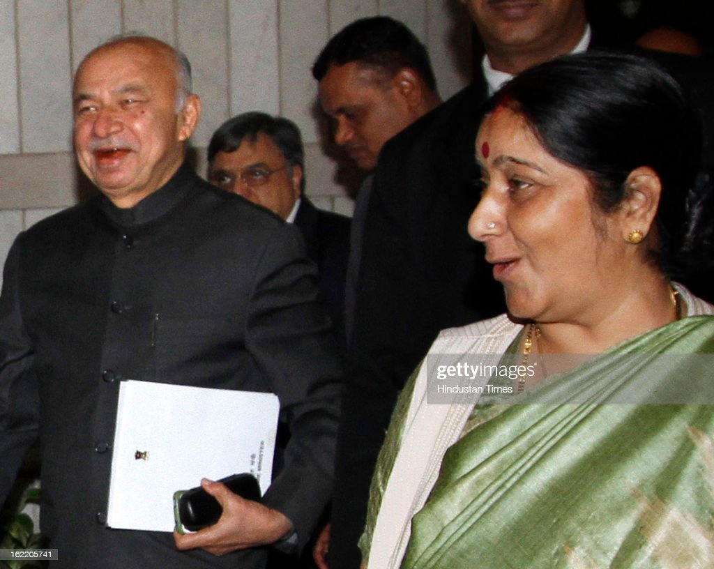 Home Minister Sushil Kumar Shinde with BJP Leader Sushma Swaraj at a All party meeting called by Loksabha Speaker coming out after lunch at Parliament House Library on February 20, 2013 in New Delhi, India. Parliament's budget session beginning on February 21, 2013 is expected to be stormy as chief opposition party BJP has announced that it would disrupt proceedings and take on the UPA government over bribery allegations on the $750-million in VVIP chopper deal. However strucking a conciliatory note Home minister Shinde Regretted his Saffron Terror remark.