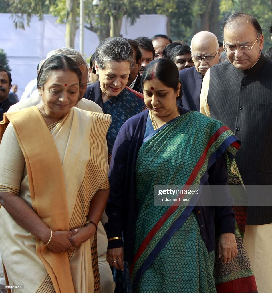 Home Minister Sushil Kumar, Speaker Lok Sabha Meira Kumar, UPA Chairpersons Sonia Gandhi, BJP Leader Sushma Swaraj, Arun Jatily, and other members of parliament before paying tributes to the martyrs of 2001 Parliament attack on its 11th anniversary, at Parliament House on December 13, 2012 in New Delhi, India.