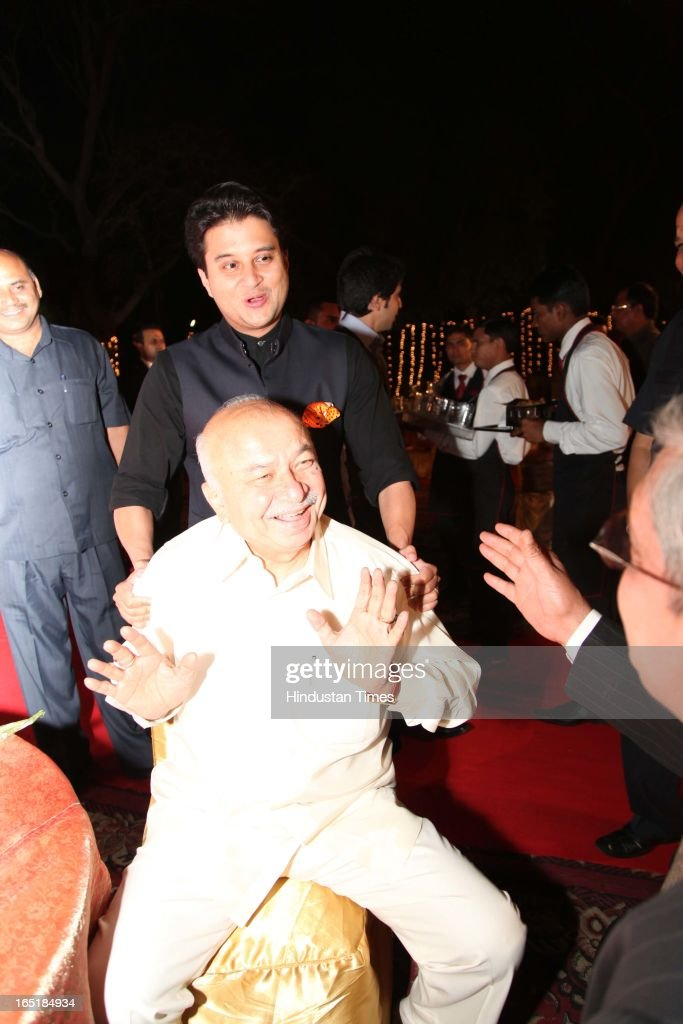 Home Minister Sushilkumar Shinde with Jyotiraditya Scindhiya at the wedding reception of educationist Dr SB Mujumdar's grandson Ameya Yeravdekar and Swati Thorat at Delhi Gymkhana on March 22, 2013 in New Delhi, India.