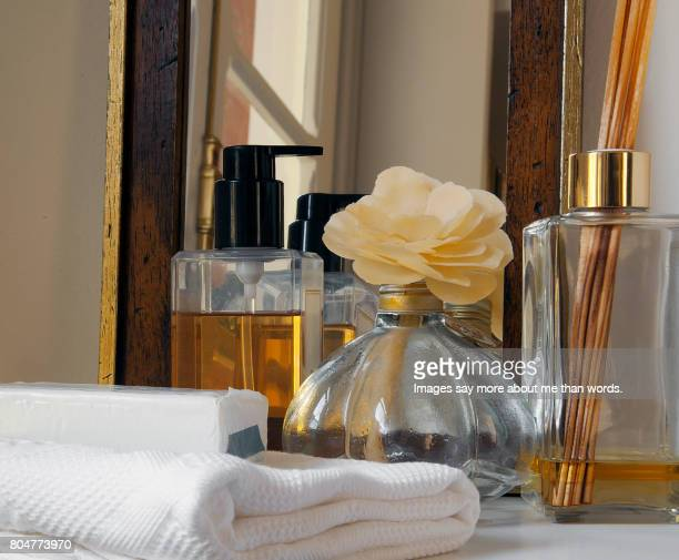 Home Moments Group of objects for relaxation: towel, soap, corporal oil, mirror and frangrance