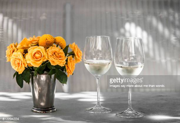 Home Moments - White wine and roses on patio in summer. Still life