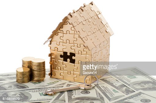 home of gold color on a dollars with coins and : Stock Photo