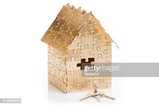 home of gold color puzzles with a keys. : Stock Photo