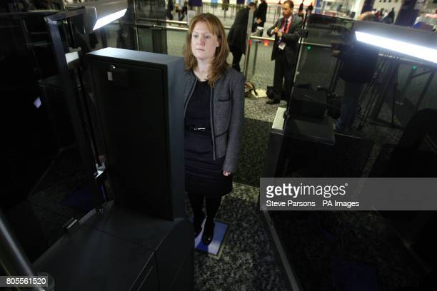 A Home Office member of staff tests out the new fast track facial recognition gates in the North Terminal of Gatwick Airport Sussex