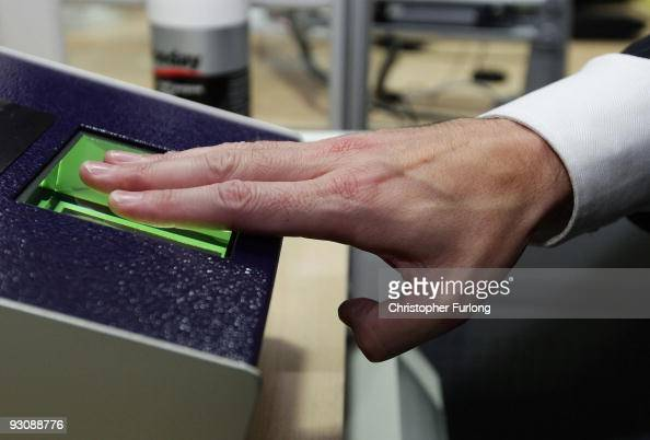 Home Office minister Phil Woolas has his fingerprints and photograph scanned as he enrols for the National Identity card at Manchester passport...