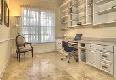 Contemporary home office with book cabinets, shelves, and workspace