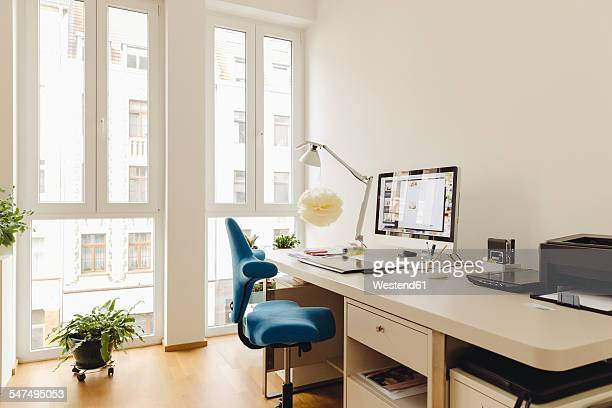 Home office with computer desk in modern building