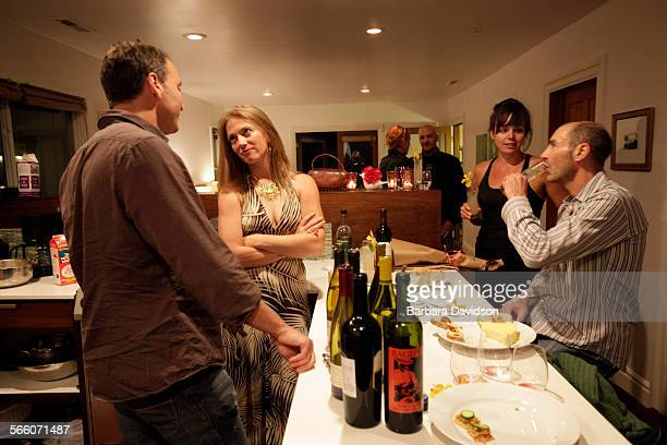 Home owner Jennifer McGarigle held a dinner party for 17 people in her Venice home May 22 2010 Chef for the evening Michael Karnow chats with...